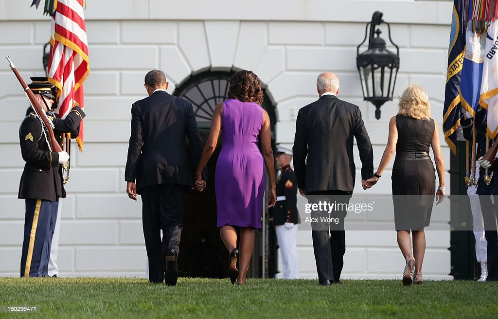 U.S. President <a gi-track='captionPersonalityLinkClicked' href=/galleries/search?phrase=Barack+Obama&family=editorial&specificpeople=203260 ng-click='$event.stopPropagation()'>Barack Obama</a>, first lady <a gi-track='captionPersonalityLinkClicked' href=/galleries/search?phrase=Michelle+Obama&family=editorial&specificpeople=2528864 ng-click='$event.stopPropagation()'>Michelle Obama</a>, Vice President <a gi-track='captionPersonalityLinkClicked' href=/galleries/search?phrase=Joseph+Biden&family=editorial&specificpeople=206897 ng-click='$event.stopPropagation()'>Joseph Biden</a>, his wife <a gi-track='captionPersonalityLinkClicked' href=/galleries/search?phrase=Jill+Biden&family=editorial&specificpeople=997040 ng-click='$event.stopPropagation()'>Jill Biden</a> return to the White House after they observed a moment of silence to mark the 12th anniversary of the 9/11 attacks September 11, 2013 on the South Lawn of the White House in Washington, DC. The nation is commemorating the anniversary of the 2001 attacks which resulted in the deaths of nearly 3,000 people after two hijacked planes crashed into the World Trade Center, one into the Pentagon in Arlington, Virginia and one crash landed in Shanksville, Pennsylvania.