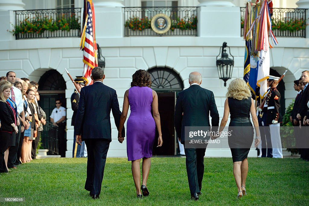 US President Barack Obama, First Lady Michelle Obama, Vice President Joe Biden and Jill Biden turn an leave after observing a moment of silence to mark the 12th anniversary of the 9/11 attacks on the South Lawn of the White House in Washington, DC, on September 11, 2013. AFP PHOTO/Jewel Samad