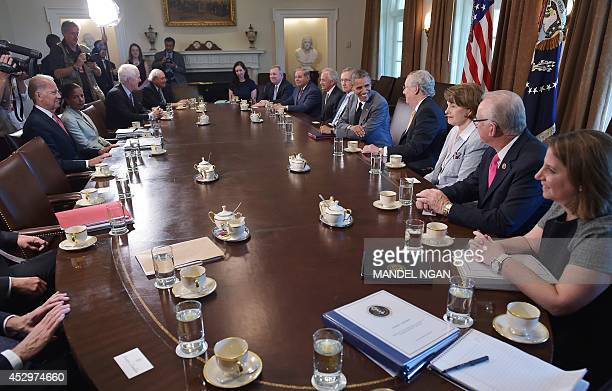 US President Barack Obama flanked by Senate Majority Leader Harry Reid DNV Obama and Senate Minority Leader Mitch McConnell RKY meets with members of...