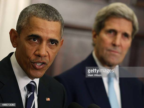S President Barack Obama flanked by US Secretary of State John Kerry announces his decision to reject the Keystone XL pipeline proposal at the White...