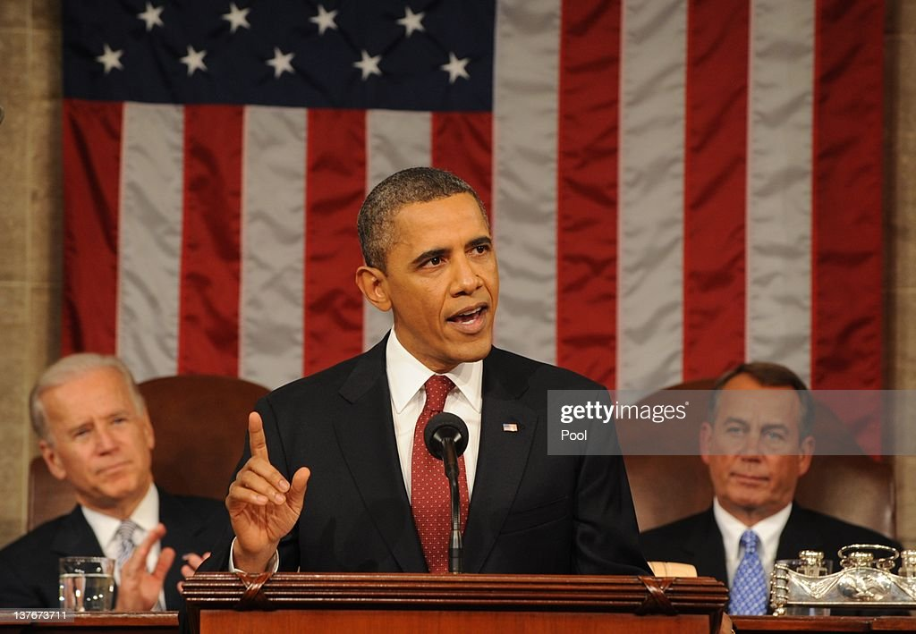U.S. President <a gi-track='captionPersonalityLinkClicked' href=/galleries/search?phrase=Barack+Obama&family=editorial&specificpeople=203260 ng-click='$event.stopPropagation()'>Barack Obama</a>, flanked by Vice President Joe Biden (L) and House Speaker <a gi-track='captionPersonalityLinkClicked' href=/galleries/search?phrase=John+Boehner&family=editorial&specificpeople=274752 ng-click='$event.stopPropagation()'>John Boehner</a> (R-OH), delivers his State of the Union address before a joint session of Congress on Capitol Hill January 24, 2012 in Washington, DC. The president made a populist pitch to voters for economic fairness, saying the federal government should more do to balance the benefits of a capitalist society.