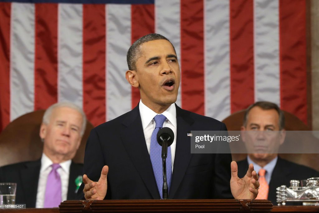 U.S. President <a gi-track='captionPersonalityLinkClicked' href=/galleries/search?phrase=Barack+Obama&family=editorial&specificpeople=203260 ng-click='$event.stopPropagation()'>Barack Obama</a>, flanked by Vice President Joe Biden and House Speaker <a gi-track='captionPersonalityLinkClicked' href=/galleries/search?phrase=John+Boehner&family=editorial&specificpeople=274752 ng-click='$event.stopPropagation()'>John Boehner</a> (R-OH), delivers his State of the Union speech before a joint session of Congress at the U.S. Capitol February 12, 2013 in Washington, DC. Facing a divided Congress, Obama focused his speech on new initiatives designed to stimulate the U.S. economy.