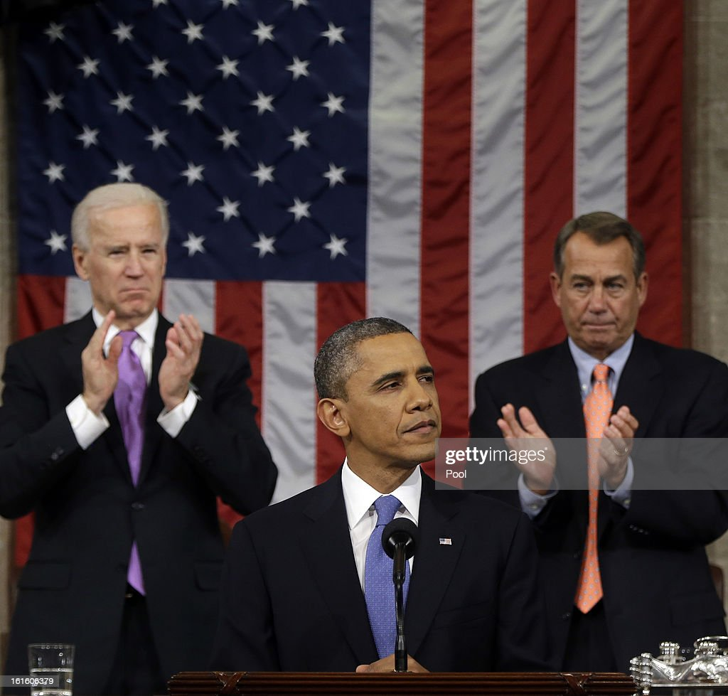 U.S. President Barack Obama, flanked by Vice President Joe Biden and House Speaker John Boehner (R-OH), delivers his State of the Union speech before a joint session of Congress at the U.S. Capitol February 12, 2013 in Washington, DC. Facing a divided Congress, Obama focused his speech on new initiatives designed to stimulate the U.S. economy.