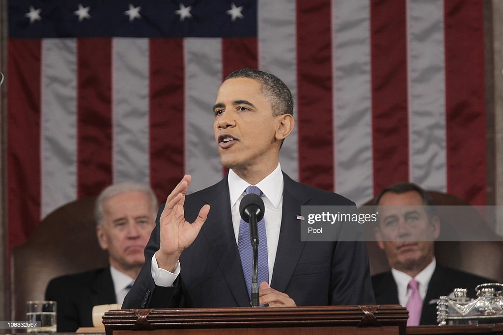 U.S. President <a gi-track='captionPersonalityLinkClicked' href=/galleries/search?phrase=Barack+Obama&family=editorial&specificpeople=203260 ng-click='$event.stopPropagation()'>Barack Obama</a> (C), flanked by Vice President Joe Biden (L) and Speaker of the House John Boehner (R-OH), delivers his State of the Union address on Capitol Hill January 25, 2011 in Washington, DC. During his speech Obama was expected to focus on the U.S. economy and increasing education and infrastructure funding while proposing a three-year partial freeze of domestic programs and $78 billion in military spending cuts.