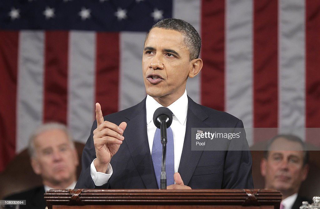 U.S. President Barack Obama (C), flanked by Vice President Joe Biden (L) and Speaker of the House John Boehner (R-OH), delivers his State of the Union address on Capitol Hill January 25, 2011 in Washington, DC. During his speech Obama was expected to focus on the U.S. economy and increasing education and infrastructure funding while proposing a three-year partial freeze of domestic programs and $78 billion in military spending cuts.