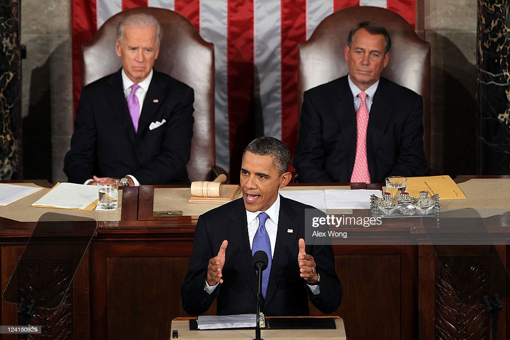 U.S. President <a gi-track='captionPersonalityLinkClicked' href=/galleries/search?phrase=Barack+Obama&family=editorial&specificpeople=203260 ng-click='$event.stopPropagation()'>Barack Obama</a>, flanked by Vice President Joe Biden (L) and Speaker of the House John Boehner (R) addresses a Joint Session of Congress at the U.S. Capitol September 8, 2011 in Washington, DC. Obama addressed both houses of the U.S. legislature to highlight his plan to create jobs for millions of out of work Americans on September 8, 2011 in Washington, DC.