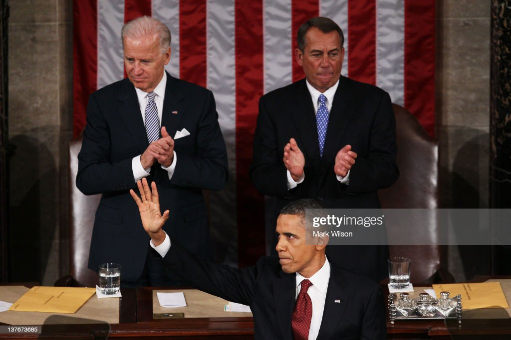 U.S. President <a gi-track='captionPersonalityLinkClicked' href=/galleries/search?phrase=Barack+Obama&family=editorial&specificpeople=203260 ng-click='$event.stopPropagation()'>Barack Obama</a>, flanked by Vice President Joe Biden (L) and Speaker of the House <a gi-track='captionPersonalityLinkClicked' href=/galleries/search?phrase=John+Boehner&family=editorial&specificpeople=274752 ng-click='$event.stopPropagation()'>John Boehner</a> (R-OH) waves to the joint session of Congress after delivering his State of the Union address on January 24, 2012 in Washington, DC. Obama said the focal point his speech is the central mission of our country, and his central focus as president, including 'rebuilding an economy where hard work pays off and responsibility is rewarded.'