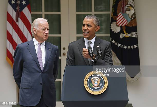 S President Barack Obama flanked by Vice President Joe Biden gives a statement on the Supreme Court health care decision in the Rose Garden at the...