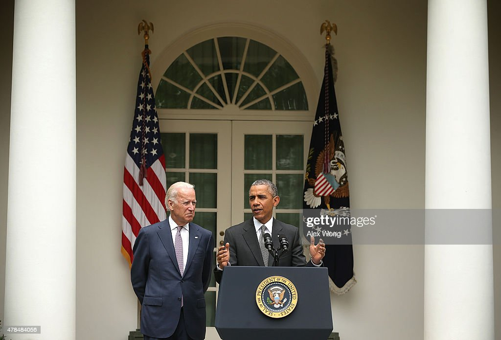 U.S. President Barack Obama (R), flanked by Vice President Joe Biden (L), gives a statement on the Supreme Court health care decision in the Rose Garden at the White House on June 25, 2015 in Washington, DC. The Supreme Court upheld the Obama health care subsidies in a 6-3 ruling.