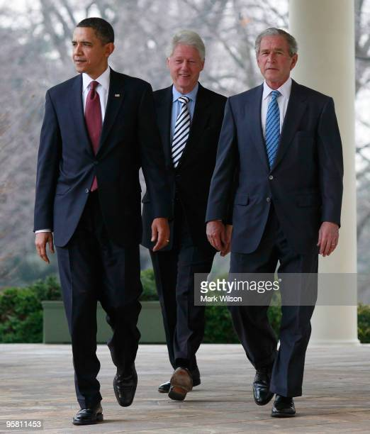 President Barack Obama former President Bill Clinton and former President George W Bush walk to the Rose Garden to speak about relief for Haiti on...