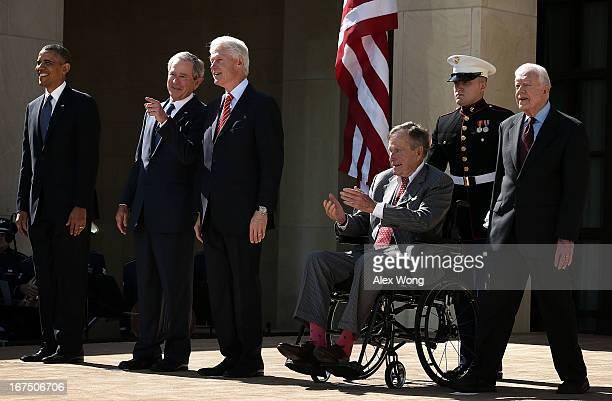 US President Barack Obama former President George W Bush former President Bill Clinton former President George HW Bush and former President Jimmy...