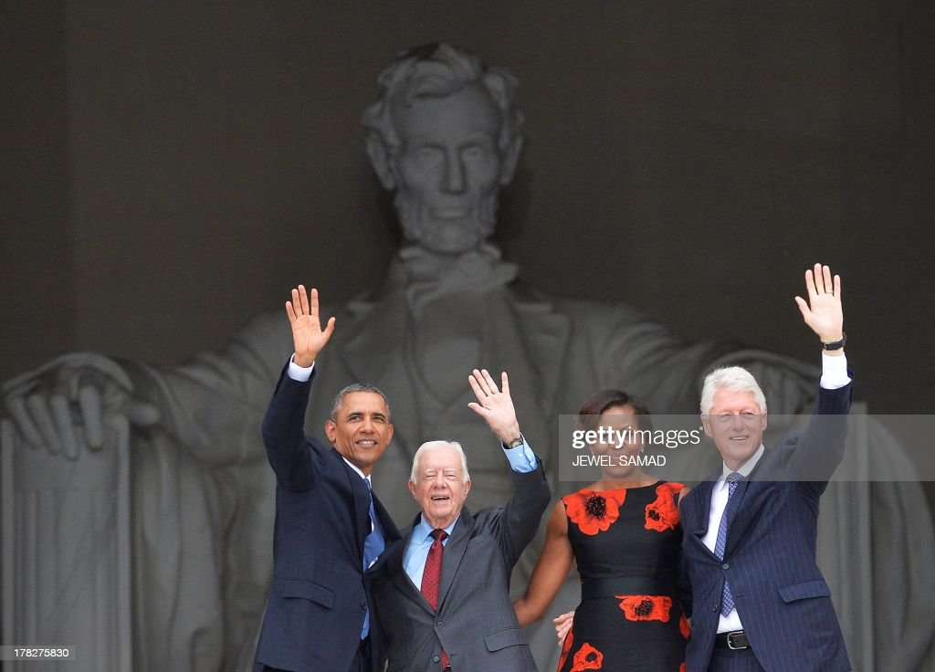 US President Barack Obama, former president Jimmy Carter, First Lady Michelle Obama and Bill Clinton wave at the end of the Let Freedom Ring Commemoration and Call to Action to commemorate the 50th anniversary of the March on Washington for Jobs and Freedom at the Lincoln Memorial in Washington, DC on August 28, 2013. The March on Washington is best remembered for King's stirring vision of a United States free of inequality and prejudice, telecast live to a nation undergoing a phenomenal decade of soul- searching, crisis and change. AFP Photo/Jewel Samad