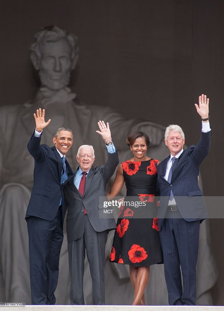 President Barack Obama, former President Jimmy Carter, first lady Michelle Obama, and former President Bill Clinton leave the stage at the conclusion of the Let Freedom Ring ceremony to commemorate the 50th anniversary of the March on Washington for Jobs and Freedom at the Lincoln Memorial in Washington, D.C., Wednesday, August 28, 2013.