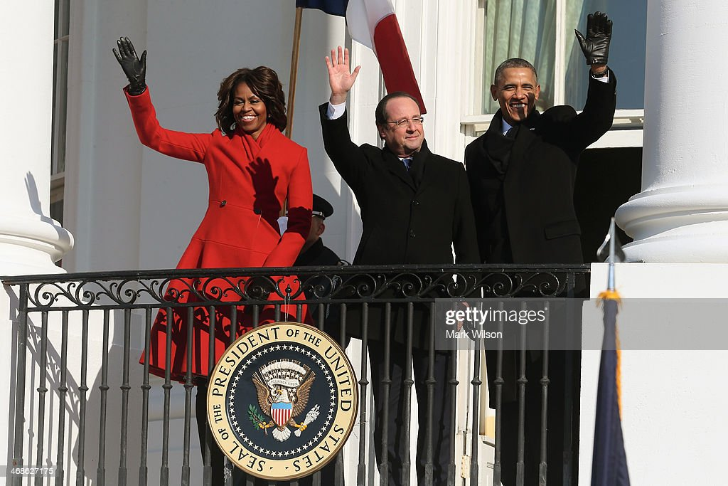 U.S. President <a gi-track='captionPersonalityLinkClicked' href=/galleries/search?phrase=Barack+Obama&family=editorial&specificpeople=203260 ng-click='$event.stopPropagation()'>Barack Obama</a> (R), French President Francois Hollande and First lady <a gi-track='captionPersonalityLinkClicked' href=/galleries/search?phrase=Michelle+Obama&family=editorial&specificpeople=2528864 ng-click='$event.stopPropagation()'>Michelle Obama</a> (L) wave during a welcoming ceremony on the South Lawn at the White House on February 11, 2014 in Washington, DC. Hollande who arrived yesterday for a three day state visit, visited Thomas Jefferson's Monticello estate and will be the guest of honor for a state dinner tonight.