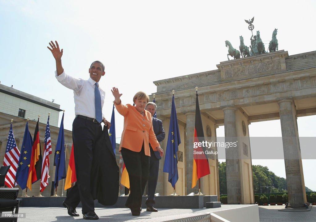 S President Barack Obama German Chancellor Angela Merkel and Berlin Mayor Klaus Wowereit depart after Obama spoke at Brandenburg Gate on June 19 2013...