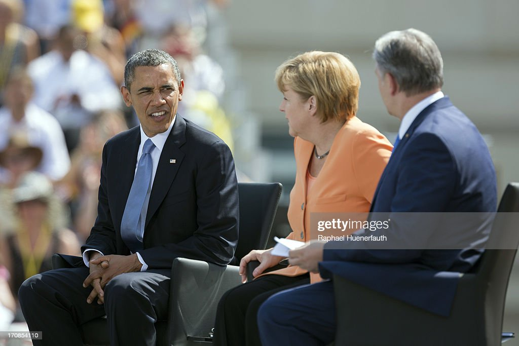US President <a gi-track='captionPersonalityLinkClicked' href=/galleries/search?phrase=Barack+Obama&family=editorial&specificpeople=203260 ng-click='$event.stopPropagation()'>Barack Obama</a>, German Chancellor <a gi-track='captionPersonalityLinkClicked' href=/galleries/search?phrase=Angela+Merkel&family=editorial&specificpeople=202161 ng-click='$event.stopPropagation()'>Angela Merkel</a> and Berlin Mayor <a gi-track='captionPersonalityLinkClicked' href=/galleries/search?phrase=Klaus+Wowereit&family=editorial&specificpeople=213527 ng-click='$event.stopPropagation()'>Klaus Wowereit</a> sit on stage in front of the Brandenburg Gate on June 19, 2013 in Berlin, Germany. Obama spoke on the east side of the Brandenburg Gate, 50 years after John F. Kennedy famously declared his solidarity with the citizens of Berlin.