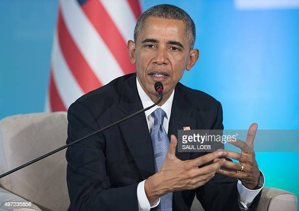 US President Barack Obama gestrues as he speaks during a meeting with Turkish President Recep Tayyip Erdogan on the sidelines of the G20 summit in...