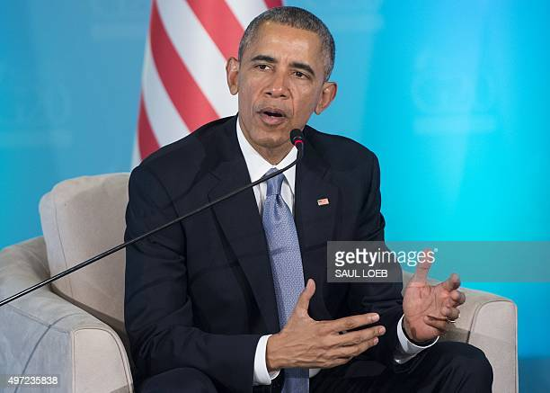 US President Barack Obama gestures as he speaks during a meeting with Turkish President Recep Tayyip Erdogan on the sidelines of the G20 summit in...