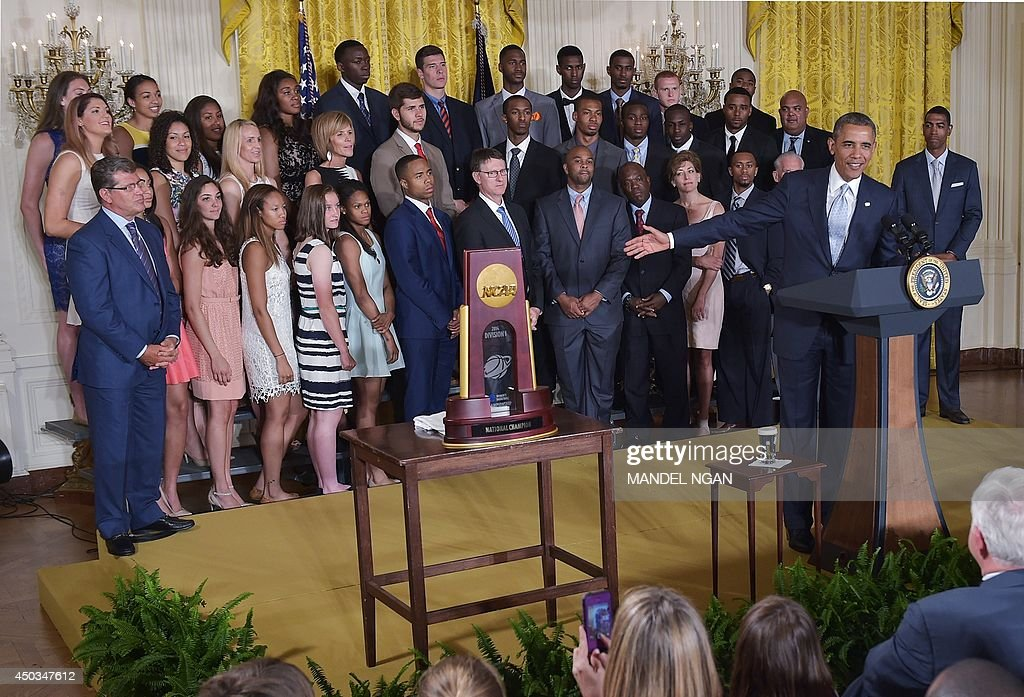 US President Barack Obama gestures during an event in honor of the NCAA 2014 Champions, the UConn Huskies Mens and Womens Basketball teams in the East Room of the White House June 9, 2014 in Washington, DC. AFP PHOTO/Mandel NGAN