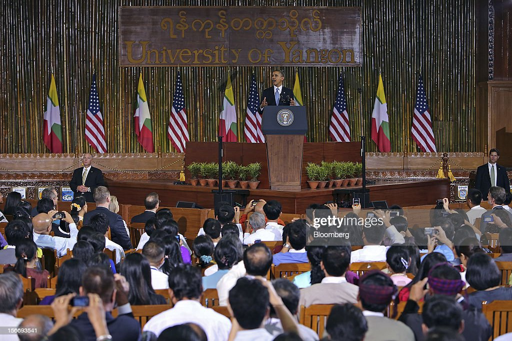 U.S. President <a gi-track='captionPersonalityLinkClicked' href=/galleries/search?phrase=Barack+Obama&family=editorial&specificpeople=203260 ng-click='$event.stopPropagation()'>Barack Obama</a> gestures during his speech at the University of Yangon in Yangon, Myanmar, on Monday, Nov. 19, 2012. Obama hailed Myanmar's shift to democracy and urged more steps to increase freedom in the first visit to the former military regime by a U.S. president. Photographer: Dario Pignatelli/Bloomberg via Getty Images