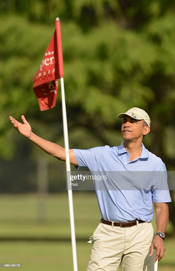 S President Barack Obama gestures on the second green at Marine Corps Base Hawaii's Kaneohe Klipper Golf Course January 2 2014 in Kaneohe Hawaii The...