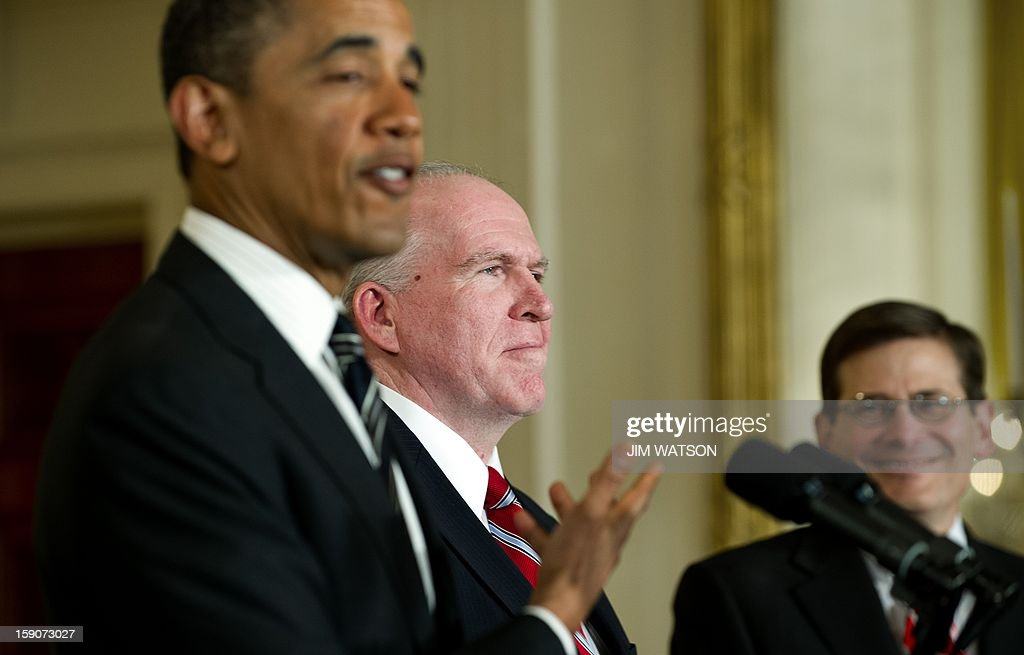US President Barack Obama (L) gestures to John Brennan (C), his nominee for Director of the Central Intelligence Agency, as Acting CIA Director Micheal Morell (R) looks on during an event at the White House in Washington on January 7, 2013. Obama also nominated former Nebraska senator Chuck Hagel to replace Leon Panetta as Defense Secretary. AFP PHOTO/Jim WATSON