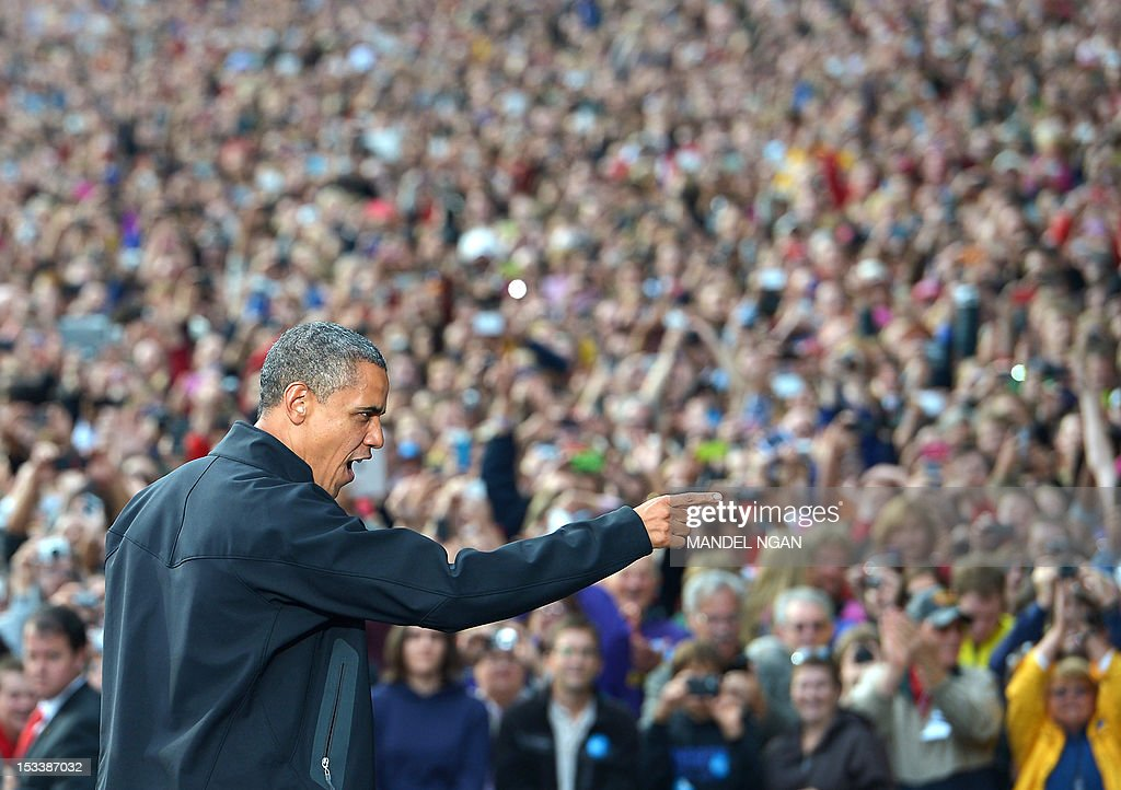 US President Barack Obama gestures to supporters as he arrives onto the stage for a campaign rally October 4, 2012 at the University of Wisconsin- Madison in Madison, Wisconsin. Obama returned to the campaign trail after taking part in the first presidential debate on October 3, 2012 in Denver. AFP PHOTO/Mandel NGAN