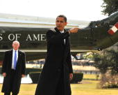 S President Barack Obama gestures towards the Oval Office after arriving from Chicago aboard Marine One on the South Lawn of the White House February...