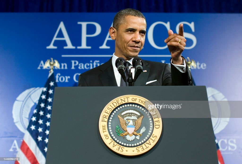 U.S. President Barack Obama gestures while delivering a keynote address during the 18th Annual Asian Pacific American Institute for Congressional Studies Gala Dinner on May 8, 2012 in Washington, D.C. APAIC is a non-profit group that works to develop Asian American leaders and politicians.