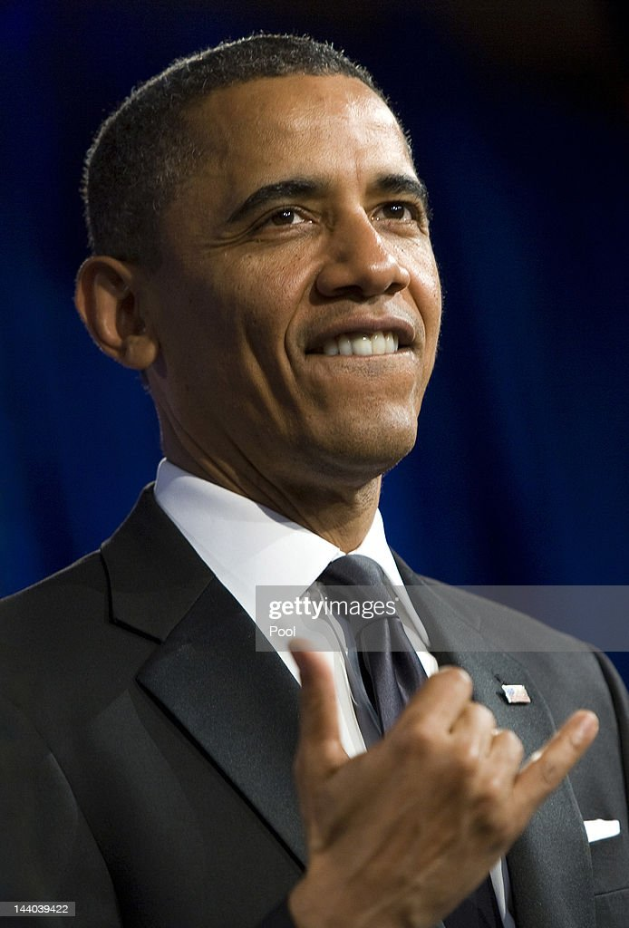 U.S. President Barack Obama gestures with a shaka prior to delivering the keynote address at the 18th Annual Asian Pacific American Institute for Congressional Studies Gala Dinner on May 8, 2012 in Washington, D.C. APAIC is a non-profit group that works to develop Asian American leaders and politicians.