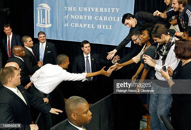 President Barack Obama gets in some final handshakes as he leaves Carmichael Arena on the the University of North Carolina campus in Chapel Hill...