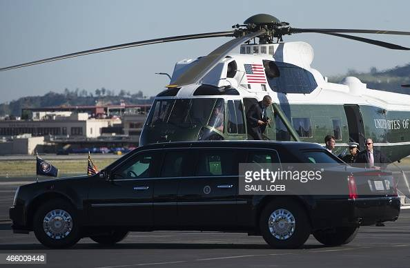 US President Barack Obama gets out of the Marine One helicopter alongside the presidential limousine upon arrival at Burbank Bob Hope Airport in...
