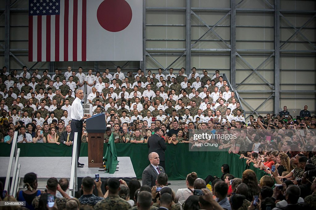 U.S. President Barack Obama (L) gives a speech to the U.S. and Japanese servicemen and their families at the Marine Corps Air Station Iwakuni (MCAS Iwakuni) on May 27, 2016 in Iwakuni, Japan. President Obama flew in to the MCAS Iwakuni on Air Force One, and visited the troops before visiting Hiroshima.