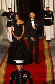 US President Barack Obama gives a thumbs up about US First Lady Michelle Obama's dress as they await the arrival of Chinese President Xi Jinping at...