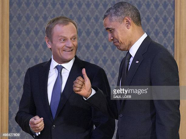US President Barack Obama gives a thumbsup as he arrives with Polish Prime Minister Donald Tusk to speak to the press following a meeting in Warsaw...