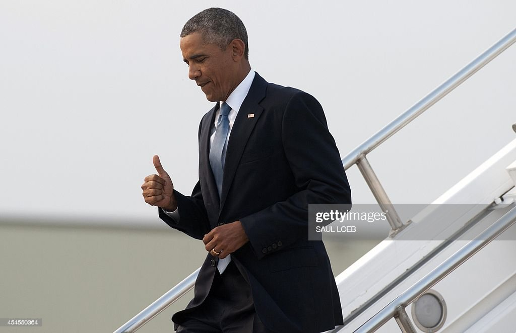 US President <a gi-track='captionPersonalityLinkClicked' href=/galleries/search?phrase=Barack+Obama&family=editorial&specificpeople=203260 ng-click='$event.stopPropagation()'>Barack Obama</a> gives a thumbs-up as he disembarks from Air Force One upon arrival at RAF Fairford in Gloucestershire, England, on September 3, 2014, on the eve of a NATO summit in Wales. AFP PHOTO / Saul LOEB
