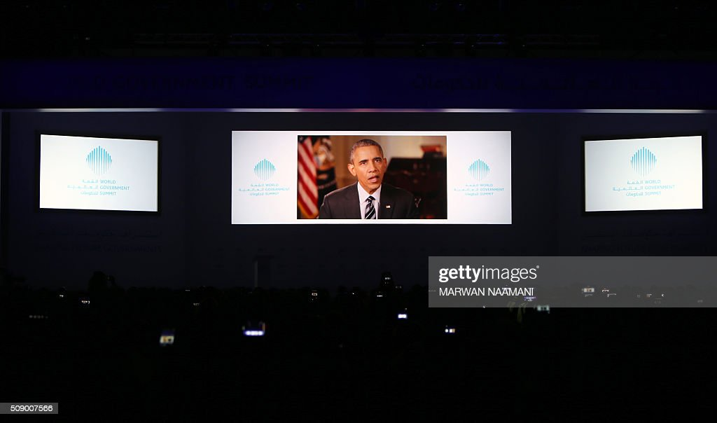 US President Barack Obama gives a video address during the opening session of the World Government Summit on February 8, 2016 in Dubai. The World Government Summit is a forum of representatives from across the globe on shaping future governments. / AFP / MARWAN NAAMANI