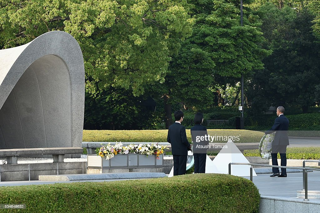 U.S. President Barack Obama gives flowers at the Hiroshima Peace Memorial Park on May 27, 2016 in Hiroshima, Japan. It is the first time U.S. President makes an official visit to Hiroshima, the site where the atomic bomb was dropped in the end of World War II on August 6, 1945.