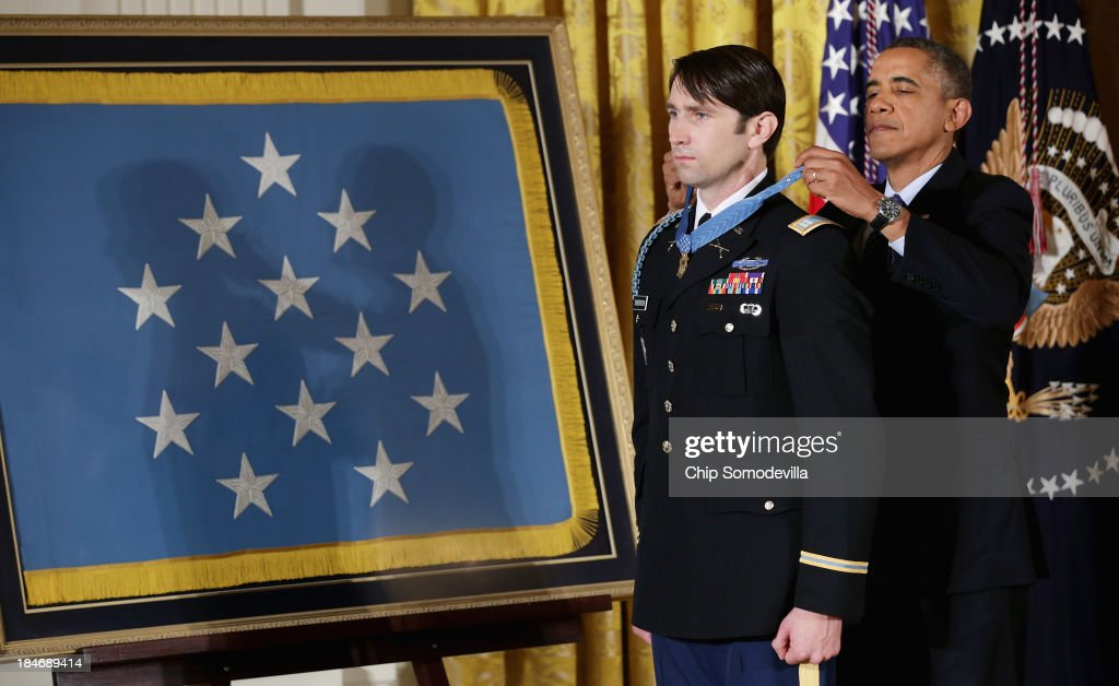 U.S. President Barack Obama gives former U.S. Army Captain William Swenson the Medal of Honor during a ceremony in the East Room of the White House October 15, 2013 in Washington, DC. Honored for his actions in the 2009 Battle of Ganjgal Valley in the Kunar Province of Afghanistan, Swenson is the sixth living veteran of the Iraq and Afghanistan wars to receive the Medal of Honor, awarded to a person who 'distinguished himself conspicuously by gallantry and intrepidity at the risk of his life above and beyond the call of duty.'