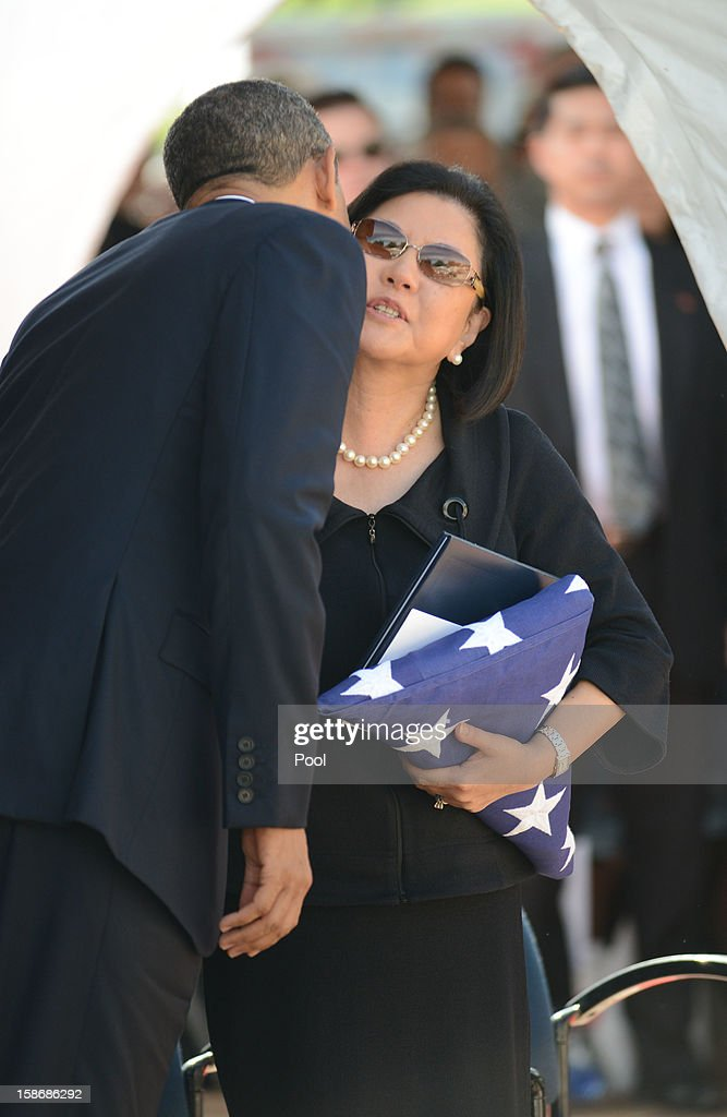 U.S. President Barack Obama gives Senator Daniel Inouye's wife Irene Hirano a kiss during the funeral services for the late Senator Daniel Inouye at the National Memorial Cemetery of the Pacific December 23, 2012 in Honolulu, Hawaii. Senator Inouye was a Medal of Honor recipient and a United States Senator since 1963.
