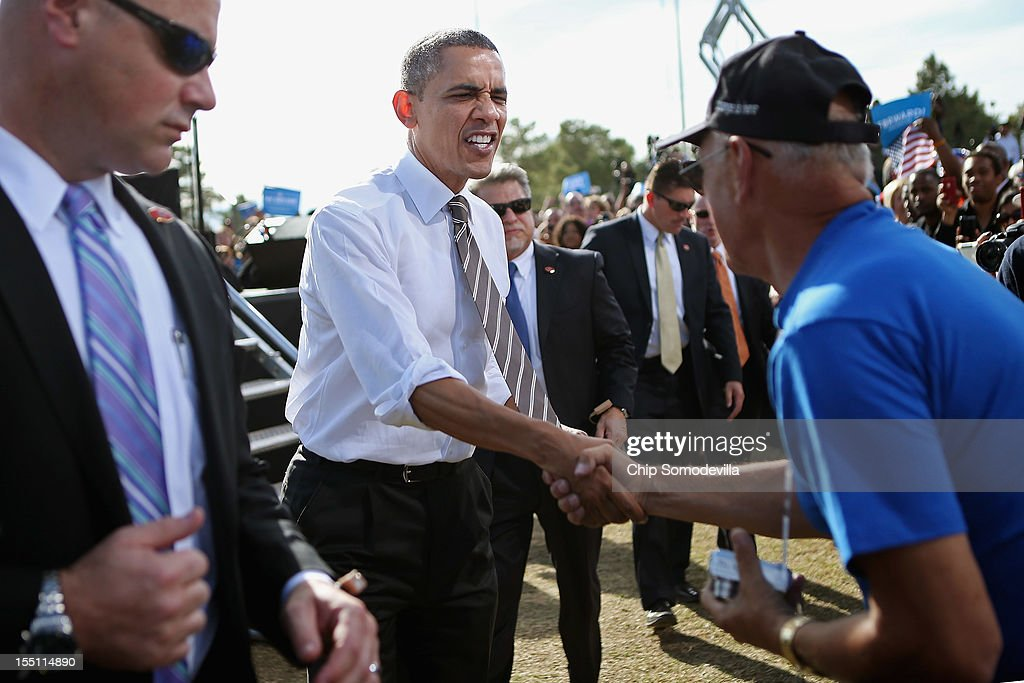 U.S. President <a gi-track='captionPersonalityLinkClicked' href=/galleries/search?phrase=Barack+Obama&family=editorial&specificpeople=203260 ng-click='$event.stopPropagation()'>Barack Obama</a> greet supporters during a campaign rally on the campus of the College of Southern Nevada November 1, 2012 in North Las Vegas, Nevada. With five days remaining in the presidential campaign, Obama travels today to Wisconsin, Colorado and Nevada after spending the last four days leading the federal government's response to Superstorm Sandy.