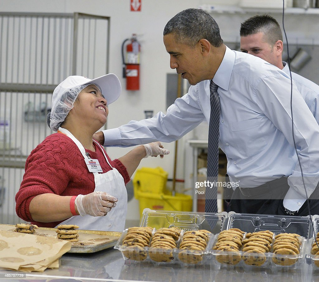 S President Barack Obama greets a Costco bakery employee during a tours of the store before speaking January 29 2014 in in Lanham Maryland Obama is...