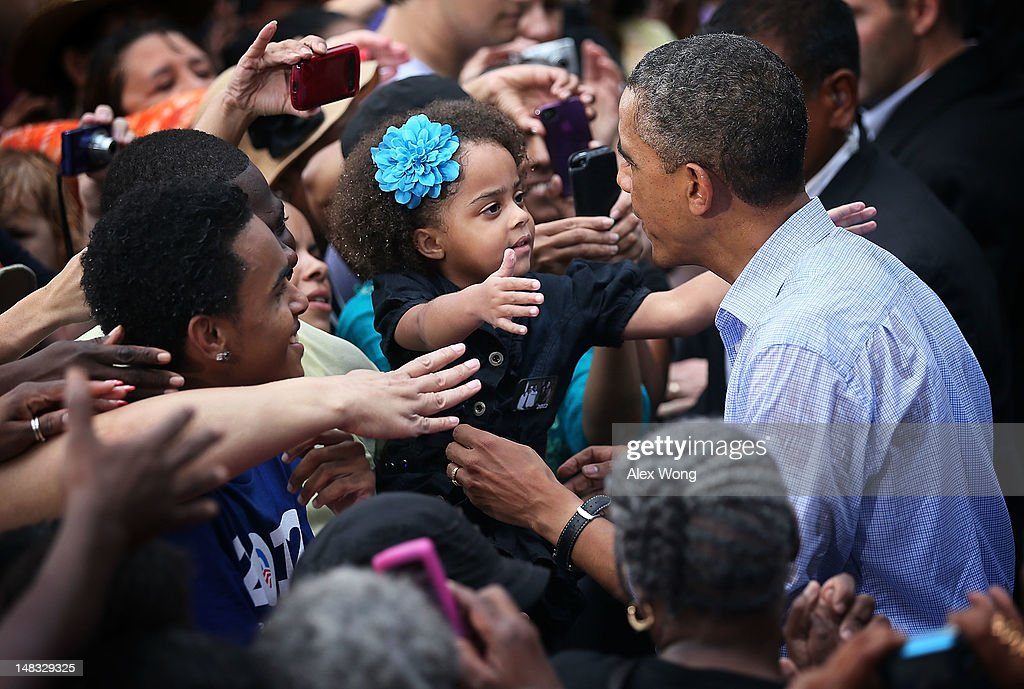 U.S. President <a gi-track='captionPersonalityLinkClicked' href=/galleries/search?phrase=Barack+Obama&family=editorial&specificpeople=203260 ng-click='$event.stopPropagation()'>Barack Obama</a> greets a young supporter at the end of his ''A Vision for Virginia's Middle Class'' campaign event July 14, 2012 at Walkerton Tavern in Glen Allen, Virginia. On the last day of his two-day campaign across Virginia, Obama continue to discuss his plan to restore middle class security and urged Congress to act on extending tax cuts to middle class families.