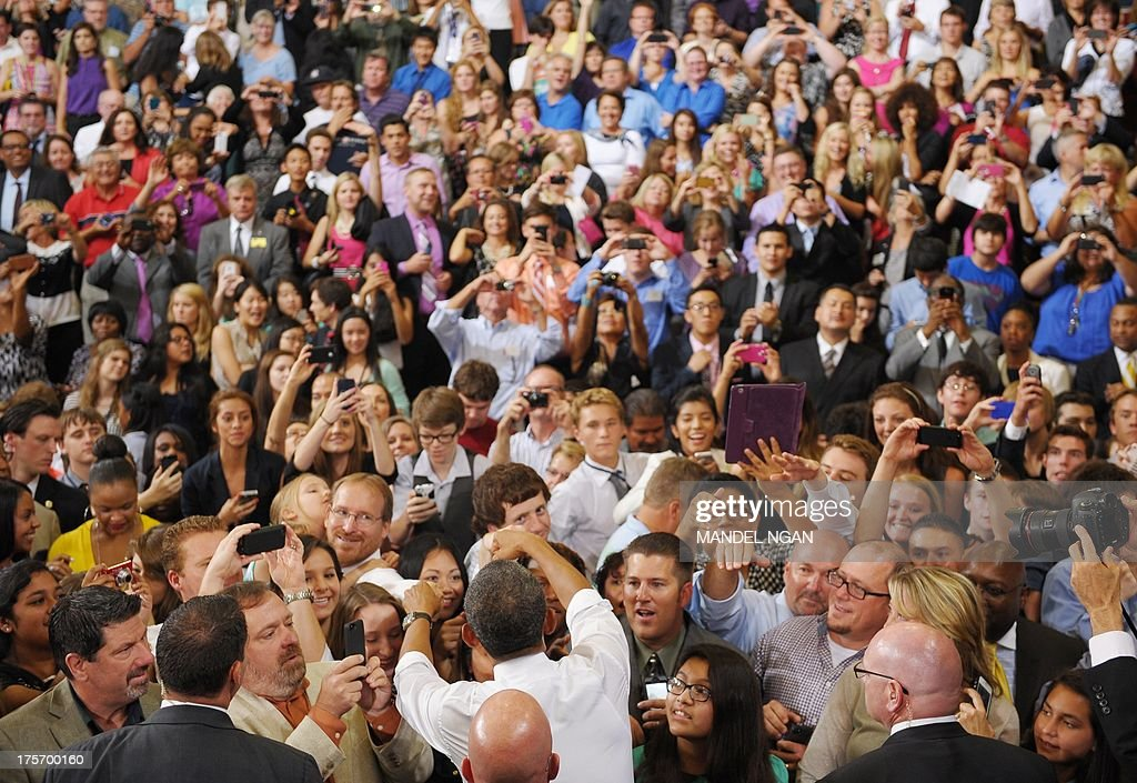 US President Barack Obama greets attendees after speaking on home ownership for the middle class at Desert Vista High School on August 6, 2013 in Phoenix, Arizona. AFP PHOTO/Mandel NGAN