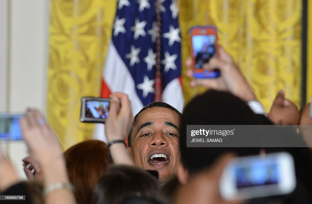 US President <a gi-track='captionPersonalityLinkClicked' href=/galleries/search?phrase=Barack+Obama&family=editorial&specificpeople=203260 ng-click='$event.stopPropagation()'>Barack Obama</a> greets attendees at the Women's History Month Reception in the East Room of the White House in Washington on March 18, 2013. AFP PHOTO/Jewel Samad