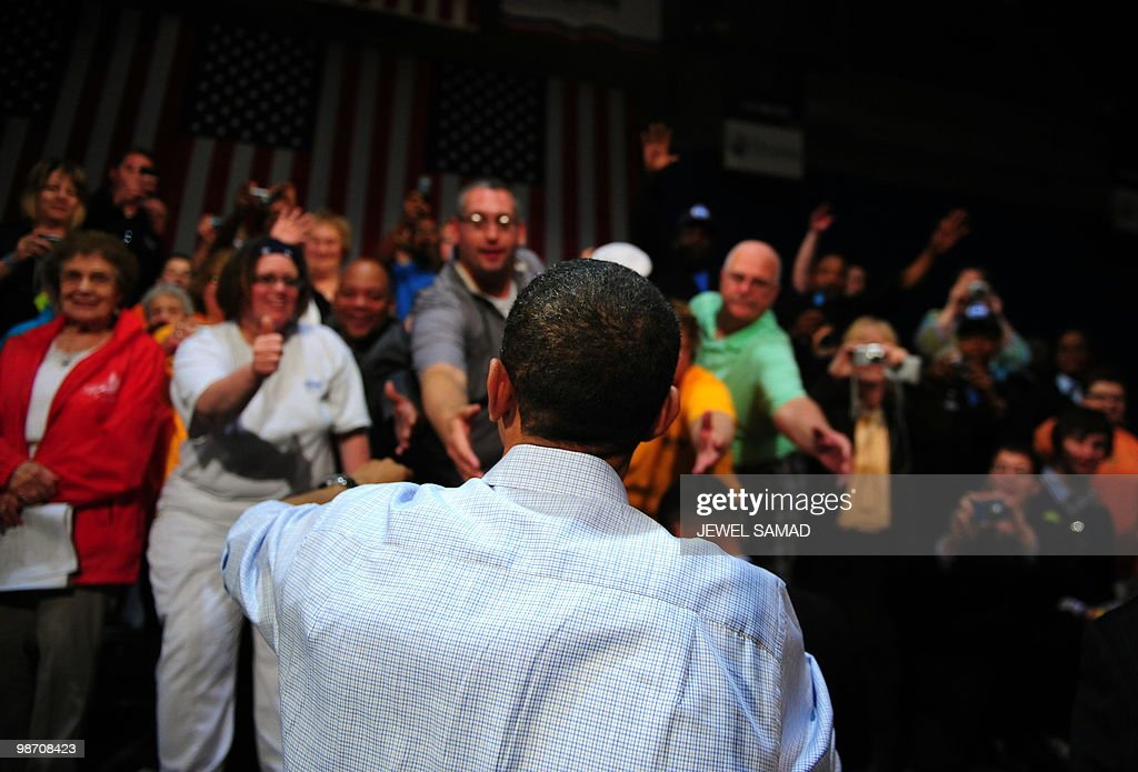 US President <a gi-track='captionPersonalityLinkClicked' href=/galleries/search?phrase=Barack+Obama&family=editorial&specificpeople=203260 ng-click='$event.stopPropagation()'>Barack Obama</a> greets audience after speaking during a townhall meeting at Indian Hills Community College in Ottumwa, Iowa, on April 27, 2010. AFP PHOTO/Jewel Samad