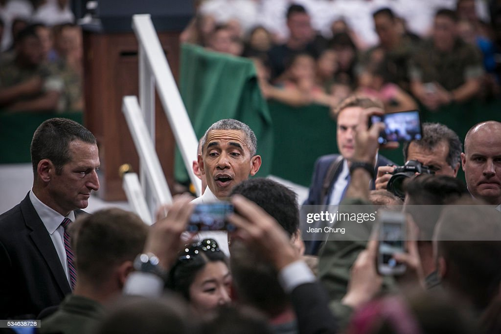 U.S. President Barack Obama greets cheering crowd at the Marine Corps Air Station Iwakuni (MCAS Iwakuni) on May 27, 2016 in Iwakuni, Japan. President Barack Obama flew in to the MCAS Iwakuni on Air Force One, and visited the troops before visiting Hiroshima.