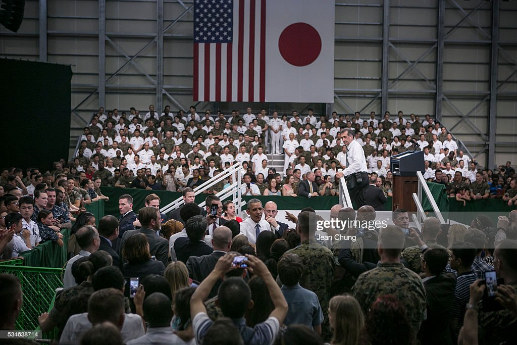 U.S. President Barack Obama greets cheering crowd of the U.S. and Japanese servicemen and their families at the Marine Corps Air Station Iwakuni (MCAS Iwakuni) on May 27, 2016 in Iwakuni, Japan. President Barack Obama flew in to the MCAS Iwakuni on Air Force One, and visited the troops before visiting Hiroshima.