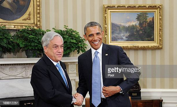 S President Barack Obama greets Chilean President Sebastián Piñera in the Oval Office of the White House June 4 2013 in Washington DC Obama and...