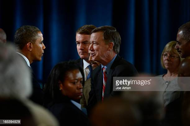 President Barack Obama greets Colorado Governor John Hickenlooper after speaking to uniformed officers and community leaders at the Denver Police...